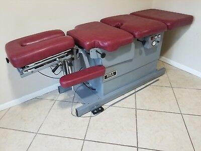 Stationary Chiropractic Table with drop pieces.