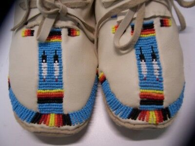 A beautiful pair of beaded moccasins in fairlynew condition.