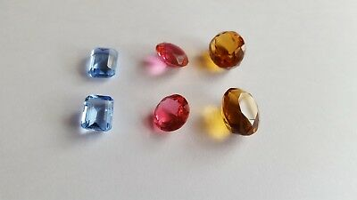 mixed natural faceted crystal cabochons, pink topaz, blue topaz and citrine
