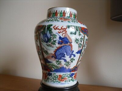 antique Chinese porcelain vase, leaping lions ?