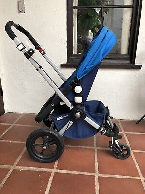 Bugaboo Cameleon Stroller System w/Bassinet, Graco car seat adaptors and covers.