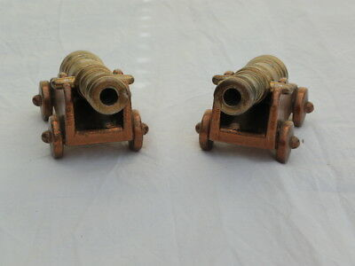 Vintage cast iron moulded Cannons x 2. 4in x 1.5in x 2in. Quite heavy