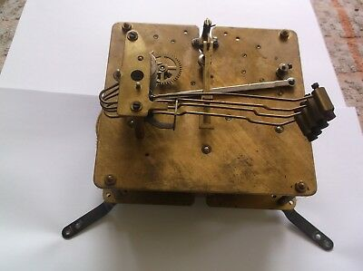 A 4 HAMMER  MECHANISM  FROM AN OLD  MANTLE CLOCK working order
