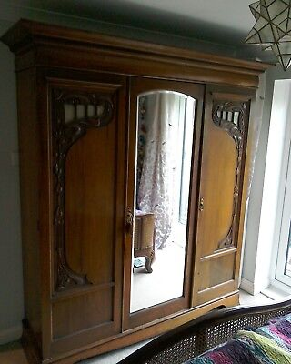 Large antique triple wardrobe with mirror, drawers, shelves, key arts & crafts