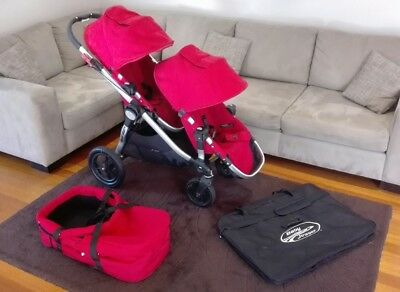 Baby Jogger City Select Double Stroller with bassinet and travel bag.