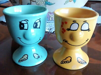 Pair of vintage character faces pottery egg cups male/female very cute