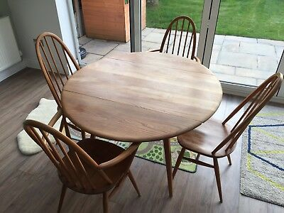 Ercol Elm dining table and four chairs