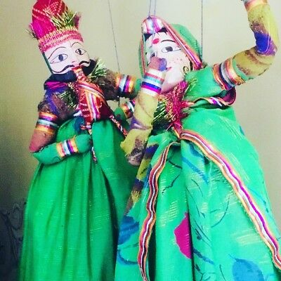 A Pair of indian Puppets In Vibrant Costumes
