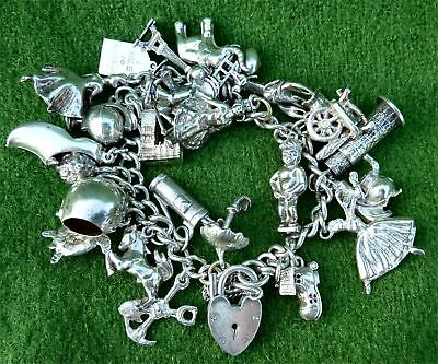 VINTAGE 1970s SILVER CHARM BRACELET FEATURING 26 DIFFERENT SILVER CHARMS 3.47.oz