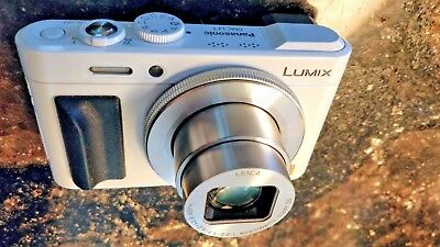 Panasonic DMC-LF1 With USB cable, 16GB card, and extra Batteries and Chargers.