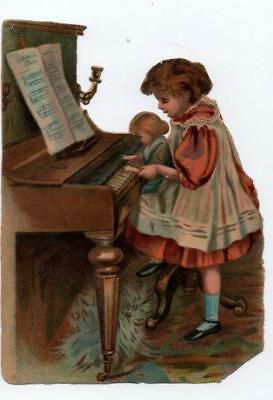 Large Victorian Die Cut Relief Scrap Girl with doll playing piano