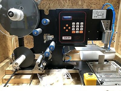 Label apllicator. Semiauto table top labeler. Tamp labeler. Three sides labeling