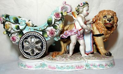 A Large Old Sitzendorf Porcelain Figurine Of A Putti With Lion Pulling A Chariot