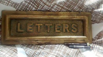 Old reclaimed brass letterbox.