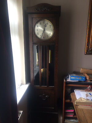 1930s long case clock with oak case three train movement and Westminster chimes