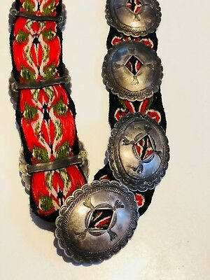 c. 1900 Navajo concha belt; red and black wool sash with 13 conchos