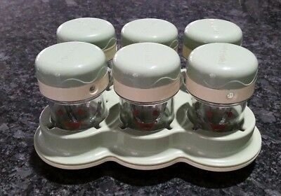 Baby Bullet 6 Cups with Date Dial Lids with Tray, Excellent Used Condition.