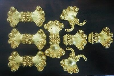 A Set of Eight Antique Lead Furnishing appliqués in 22 Carat Gold Leaf (French)