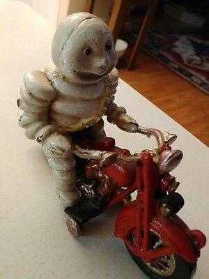 ORIGINAL VINTAGE 1950s CAST IRON MICHELIN MAN ON MOTORCYCLE .