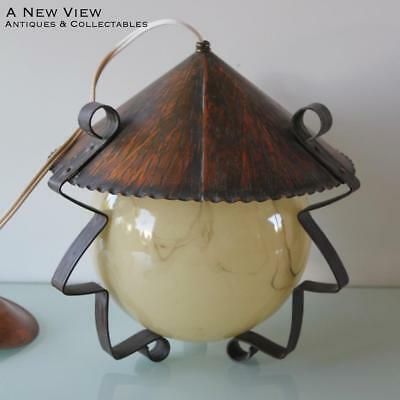 Art Deco glass brown glass marble lamp shade with copper roof.