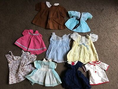 Lot of antique and vintage doll dresses.