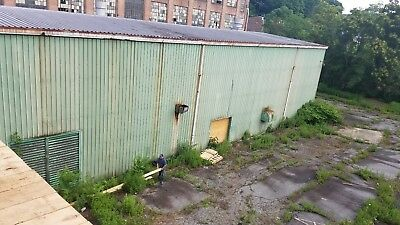 Steel Building aprox 60 feet by 120 feety 40 ft tall green building 2 trolley