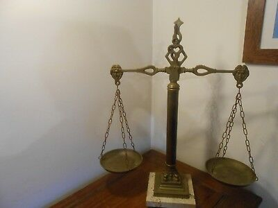 Vintage French hanging balance scales in brass and metal on marble plinth