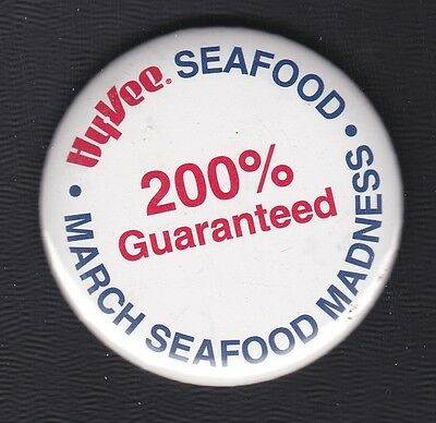 """Hy-Vee grocery pinback, March Seafood Madness, 2.5"""" wide"""
