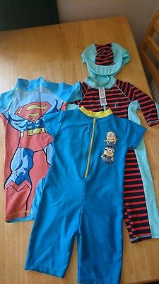 3x Boys Swimsuit/ Sunsuits Age 4-5.  1x hat.Superman and minions.