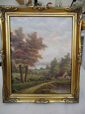 pretty old  oil painting on canvas housed in a gilt frame..