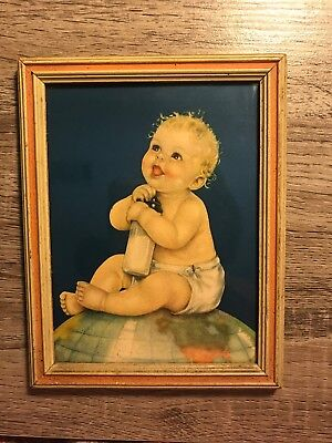 Quaint Vintage Framed Print of Baby w/Bottle Sitting on Globe Marked 1310 & 1933