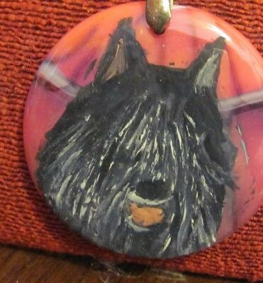 Bouvier des Flandres hand painted on round, red pendant/bead/necklace