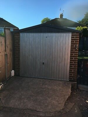 Concrete garage with electric door (Free to collector)