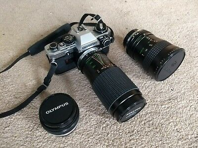 Olympus OM10 35mm SLR Film Camera with 50mm, 28-80mm and 80-200mm zoom lenses.