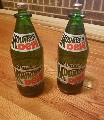VINTAGE MOUNTAIN DEW  2 LITERS  BOTTLES full with LID