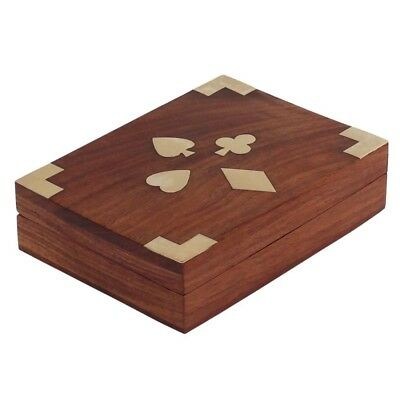hand carvedtreasue chest in wood featuring playing card motifs