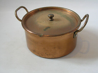 vintage lidded copper pot with 2 handles could be used as a planter