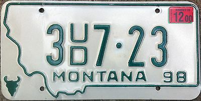 Montana State License Plate With Green Letters On Creme Backround