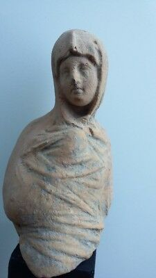 upper part of a hellenistic terracotta of a veiled lady     3th century BC