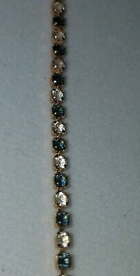 COLLECTIBLE VINTAGE AVON Blue and clear stone TENNIS BRACELET, gold tone,preown