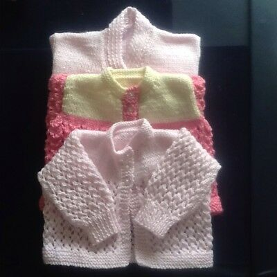Three hand knitted baby matinee Coats/cardigan.  Proceeds To Cancer Research.