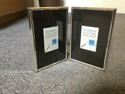 a double picture frame, silver plated on solid brass