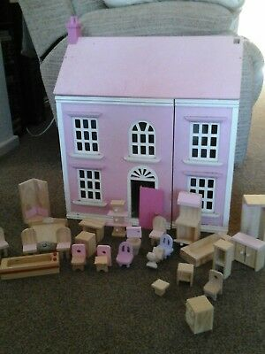 Lovely wooden dolls house with furniture