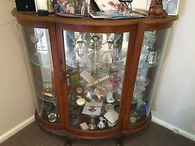 Glass Display Cabinet Vintage. Wood and glass cabinet.