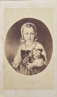 CDV Genre filler card of a young girl with a marionette (frowning)