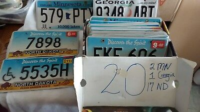 license plates- 20 plates, 2 mn, 1 Georgia, 1 handicap, north Dakota