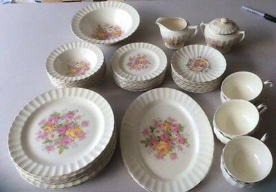 The Edwin Knowles China Company Large Lot Fluted Pink Yellow And White Roses.