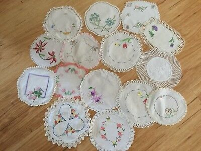 15 small hand embroidered doilies