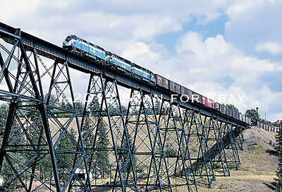 Great Northern Sky Blue F45 and SD45's on a high trestle LARGE Postcard - MINT!