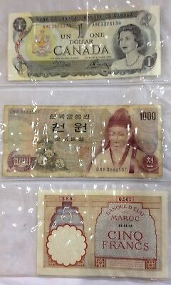 Three pages of collectible vintage paper bill currency (CAN, KOR, Chile,GER,ect)